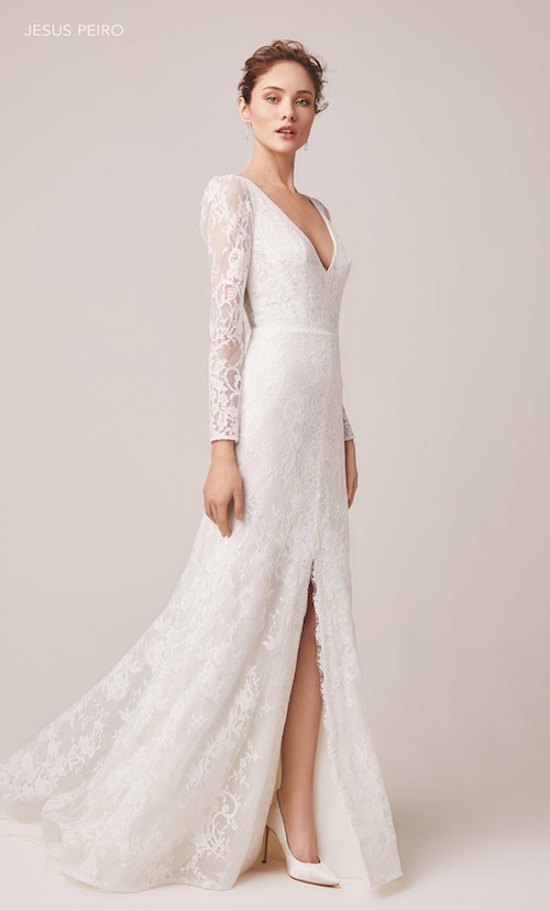 Draped sleeves frame this allover lace fit and flare gown. With an illusion plunge neckline, you will be remembered in this sultry look.